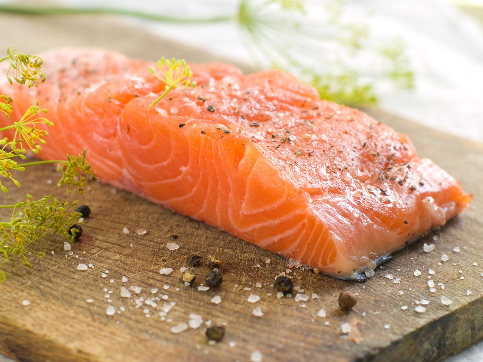 14748185 - fresh salmon fillet on wooden board, selective focus